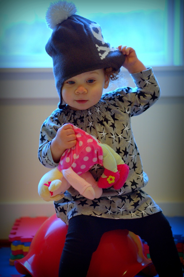 Baba said we could go outside and play again if I wore my hat.  I...HATE...HATS!!  And no my dolly isn't dead!