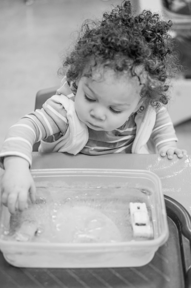 """At her """"First Experiences"""" class at the Children's Museum learning about ice and snow."""