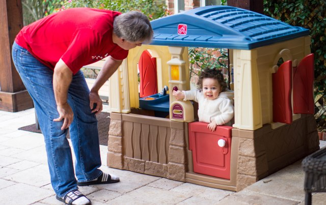 Having fun in her outside play-house that Memaw and Papa got her...she rings the doorbell over and over and over again.