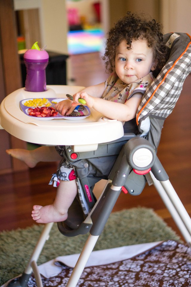 """Eating some lunch in her """"hi-chair!""""."""