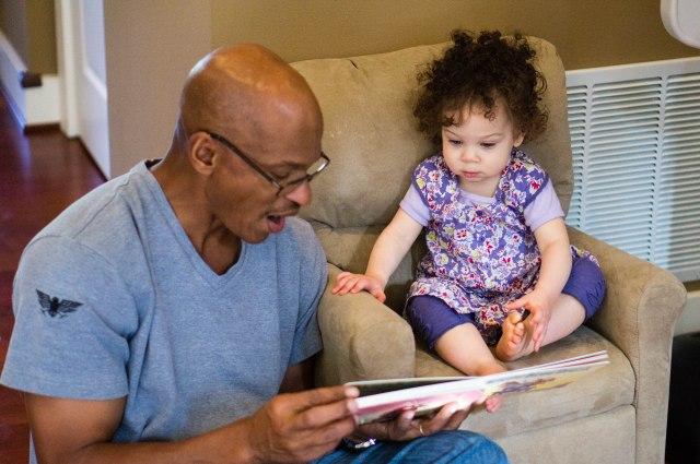 Reading with Grandpa.