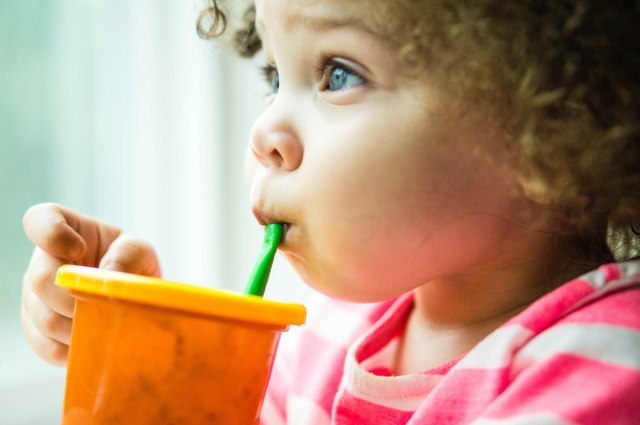 Drinking her smoothie...watching the yucky rain.