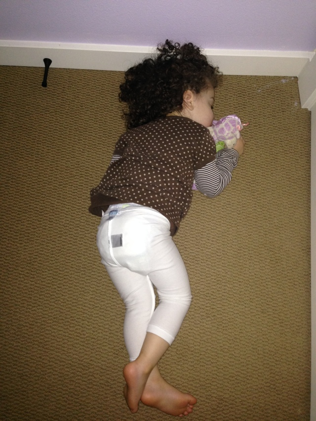 She actually put her pants back on here!  Was put in bed for nap...protested by running around her room pantless...then they somehow made it back on!  They may be inside-out...but they are on!