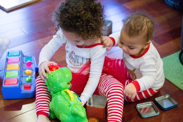 Payton thought all the toys were hers, Miles trying to gain control back of his dino.